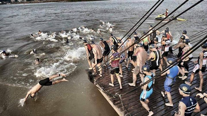 Race start is from a barge anchored in Laos