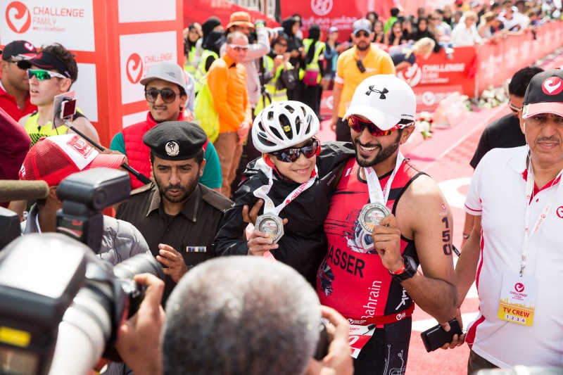 Shaikh Nasser took 12-year-old Ghanim, born without legs, on the swim, bike and run at Challenge Dubai. Photo: Sascha Deforth