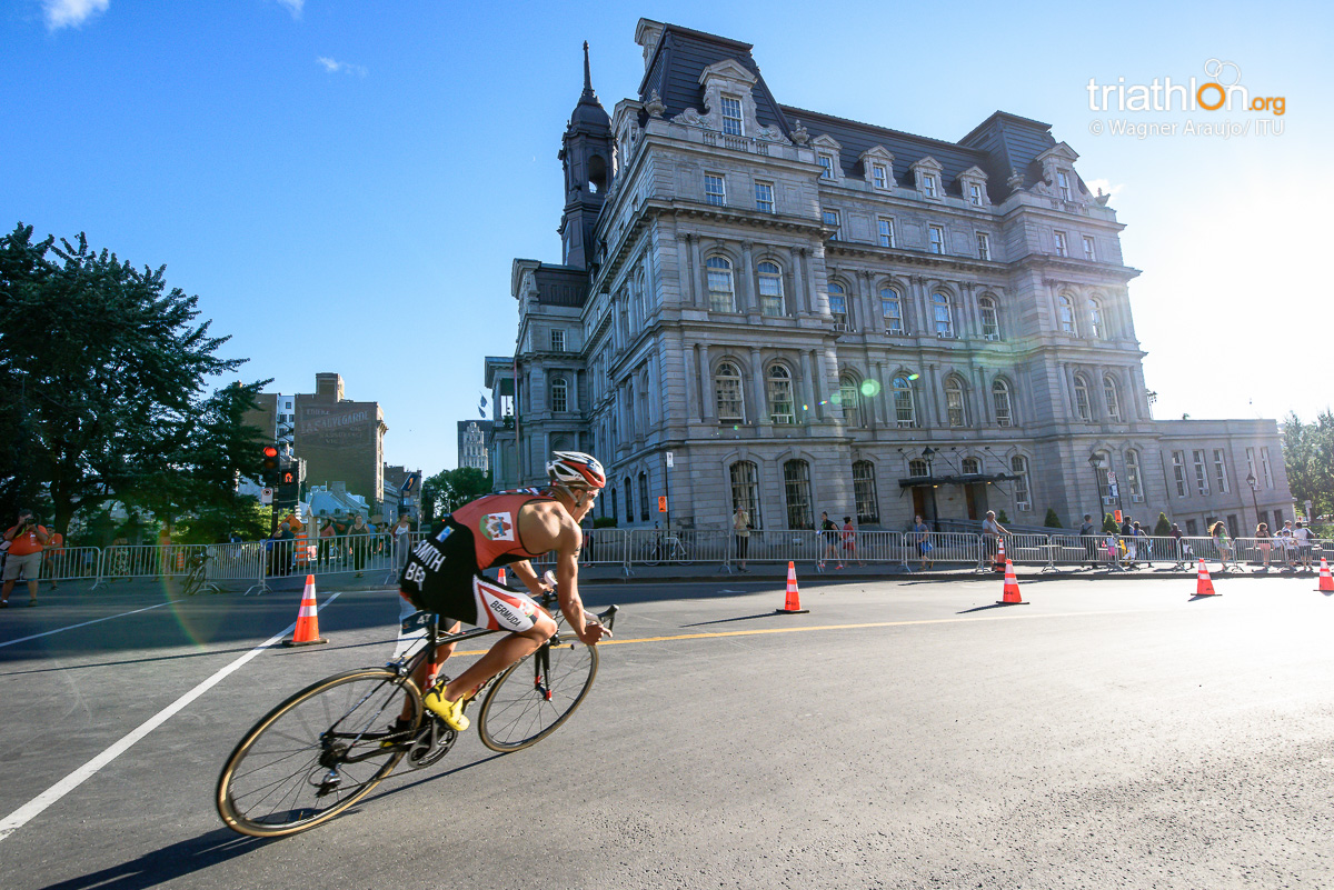 An athlete cornering at the beautiful bike course of ITU's World Cup in Montreal, Canada