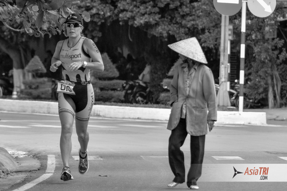 A local pedestrian among the athletes at Challenge Vietnam
