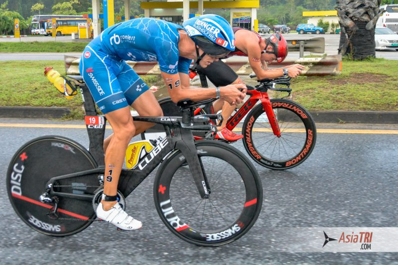 Michael Raelert and Tim Reed riding side by side at Ironman 70.3 Phuket