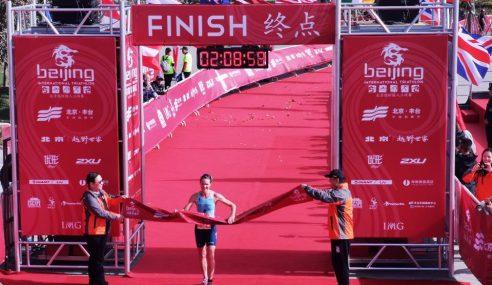 Mario Mola and Flora Duffy Win 2019 Beijing International Triathlon